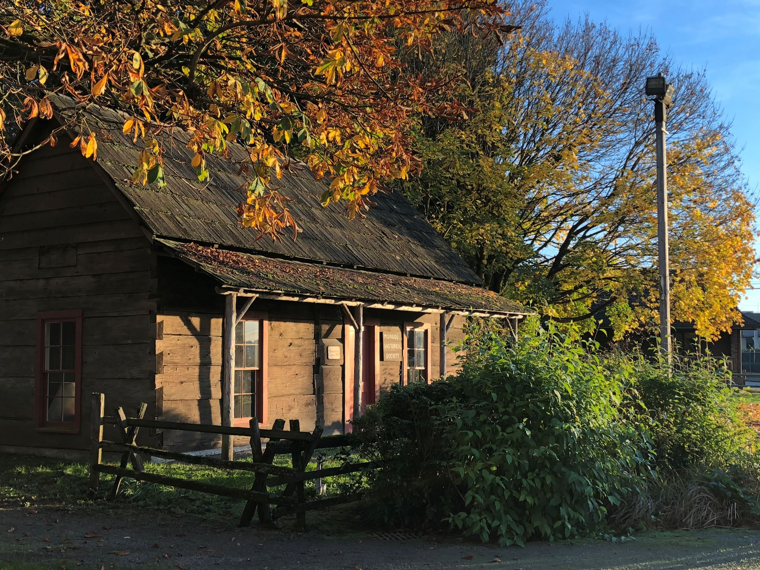 "Photo of Shannahan Cabin courtesy of ""The Evergreen State Fairgrounds."""