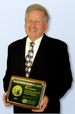 Bill Lewallen holding the Environmental Excellence Award